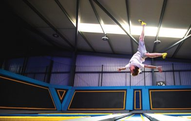Boy somersaulting in trampoline park
