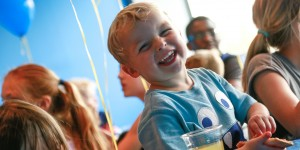 Boy at trampoline park party smiling