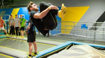 Boy jumping into giant airbag at trampoline park