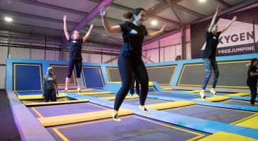 Fitness jump smiling airborne