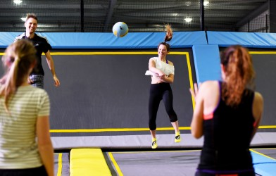 team plays trampoline dodgeball at oxygen