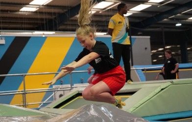 Girl jumps at amazing trampoline park