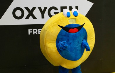 funny oxygen freejumping mascot jumping on trampoline