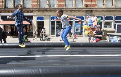 children bouncing on big airtrack