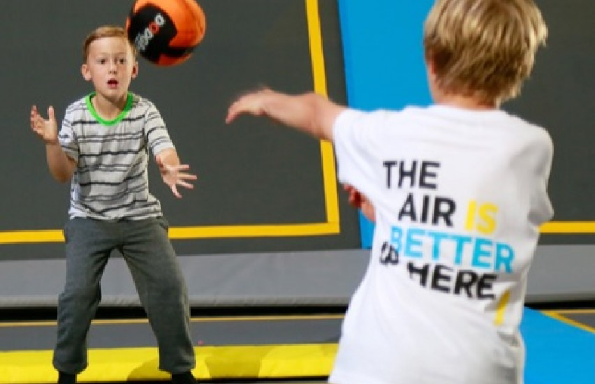Kids playing dodgeball in a trampoline park