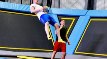 Boy getting hit by dodgeball on a trampoline