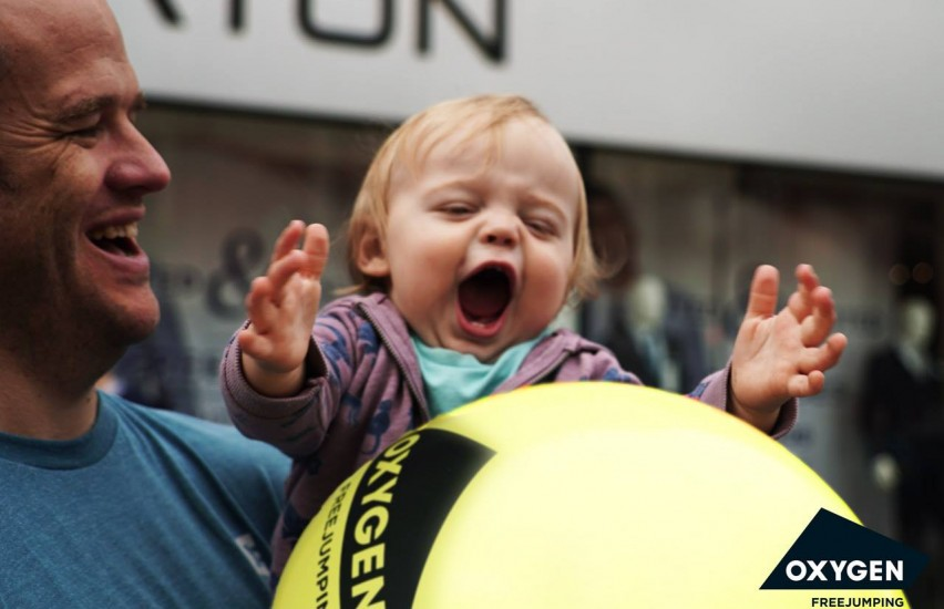 baby holding balloon in Derby