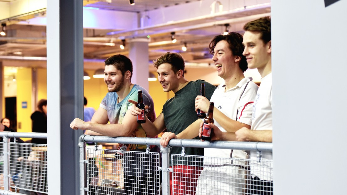 a group of people laughing at a trampoline park
