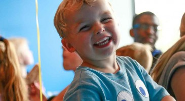 laughing boy at trampolining party