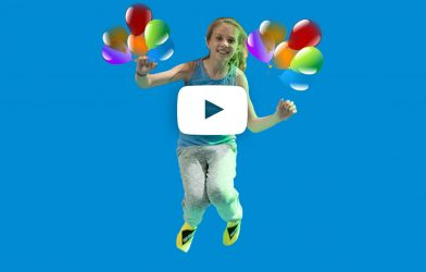 Girl jumping on blue background with balloons and trampoline park party